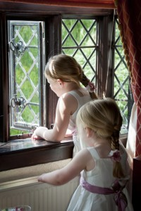 Two little Bridemaids looking through the window