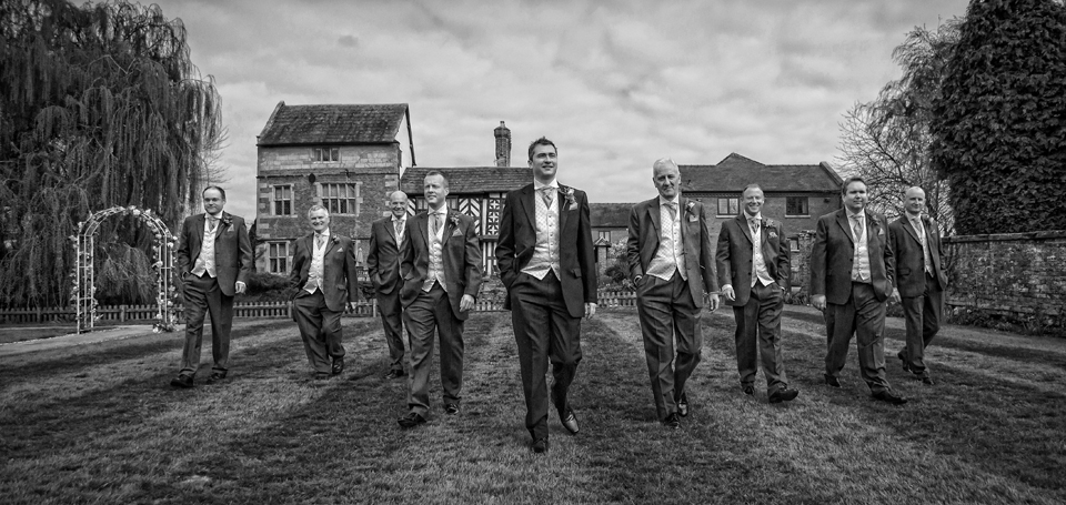 Groom and Groom's Men walk across the lawn