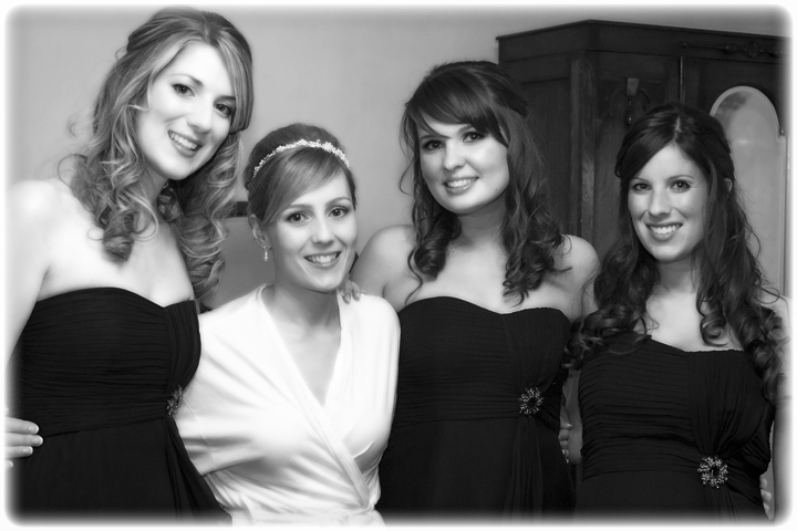 Bride hugs her Bridesmaids