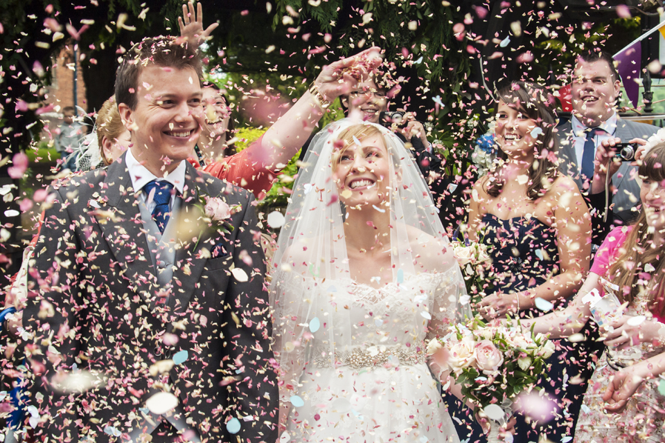 Bride and Groom showered with confetti at Church