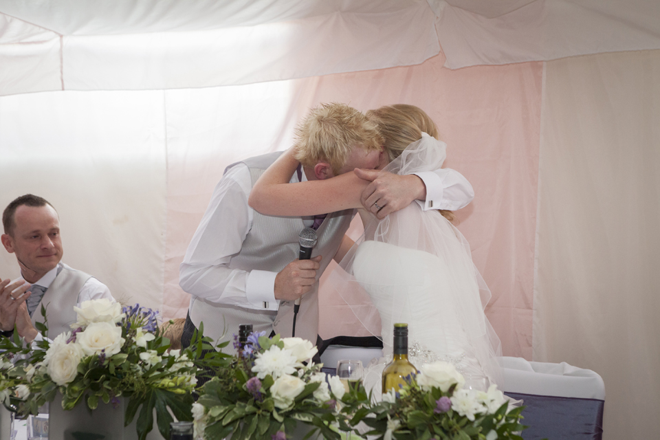 Groom and Bride hug during speeches