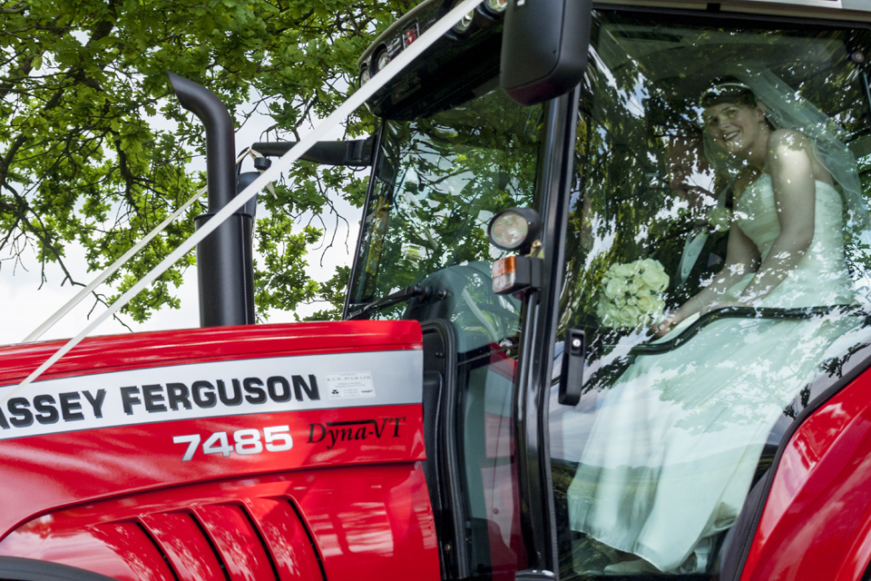Groom drives his Bride to the Reception at Maesmawr Hall in a tractor