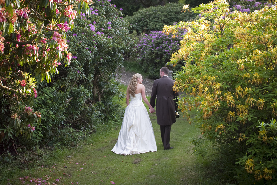 Bride and Groom wander through grounds at Walcot Hall
