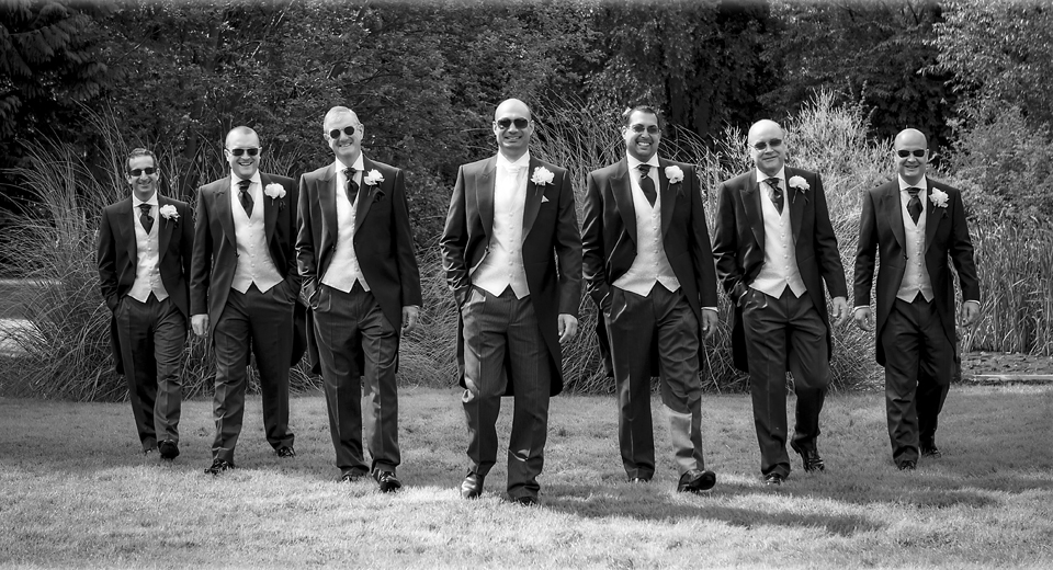 Groom and Groom's Men walk in the grounds