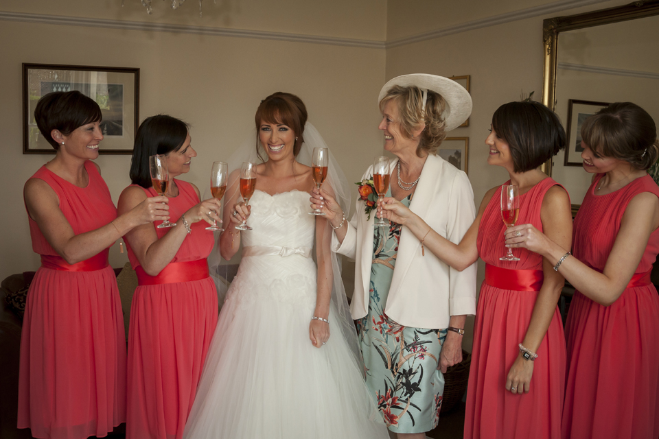 bride and girls have a pre-wedding toast