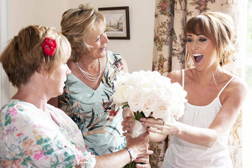 wedding bride seeing her bouquet